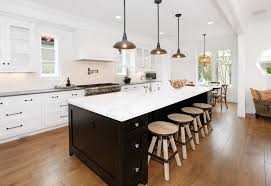 3 black iron pendant lamps over kitchen island butcher block with seating and marble countertop black modern kitchen pendant lights