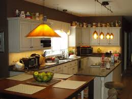 above complete kitchen remodel hanging pendant lights over island and over sink hanging light over table recessed lights not illuminated above cabinet lighting