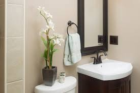 apartment small bathroom decorating ideas with vanity with coabinet and white ceramic sink also toilet seat ceramic purple black white