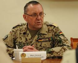 Richard Rossmanith, International Security Assistance Force deputy chief of staff for stability from Heidelberg, Germany, discusses a topic during a brief ... - 450x360_q75