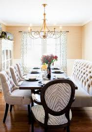 tufted dining bench with back posh interiors austin dining rooms dining room brass chandelier tufted bench