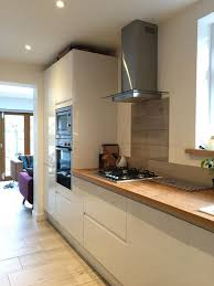 kitchen worktops ideas worktop full: howdens white gloss intergrated kitchen with solid oak full stave worktops wood effect porcelain