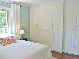niesz vintage elegant master bedroom photo in cincinnati with blue walls and medium tone hardwood floors bedroom wall bed space saving furniture ikea