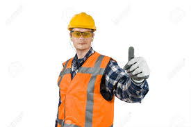 a construction worker wearing the proper safety precautions a construction worker wearing the proper safety precautions giving a thumbs up