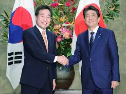 <b>Japan and South Korea</b> promise to work on bilateral ties amid ...