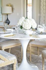 picture dining white tulip table with bring white table scape