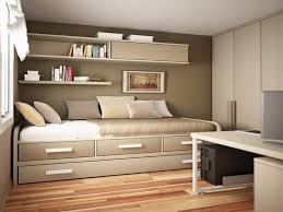 guest bedroom and office combination light brown mat pastel red lush rug white open bookcase light brown carpet purple stripe white color scheme bedroom guest office combination