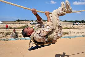 u s department of defense photo essay an italian sailor negotiates a rope obstacle during the annual multinational force and observers annual skills