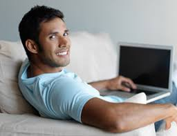 Gay single man on laptop EliteSingles