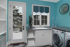 good looking valance curtains in laundry room contemporary with shelves over washer and dryer next to hidden washer dryer door alongside metal wall art and bright modern laundry room