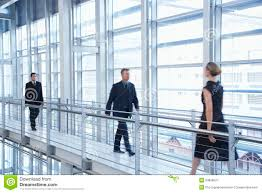 business people walking by railing in modern office business office modern