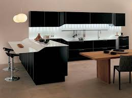 black modern kitchen cabinets with white countertop two pendant lights two black acrylic bar stools rectangular wooden table and grey fabric upholstery black modern kitchen pendant lights