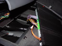 xc custom stereo install this is where my wires came out from the rear from there you can also easily run up into the center console