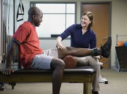 quiz should you become a physical therapist female physical therapist assisting man leg exercise