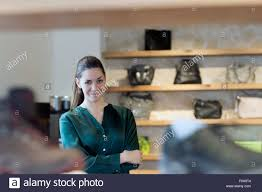 portrait of proud female s assistant in shoe shop stock photo portrait of proud female s assistant in shoe shop