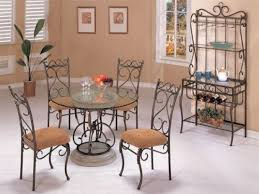 round black wrought iron table with curving legs also black iron chairs with round seat black wrought iron furniture