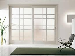white kitchen windowed partition wall: furniture frosted glass room partition with white wooden frames connected by black folding chair