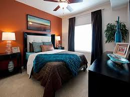 love this room the orange accent wall with teal and brown bedding is brown room pinterest walls