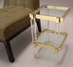 unusual clear acrylic furniture beside dark brown wooden chair with dark cream fabric pad on clean white floor acrylic furniture toronto