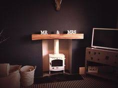 rustic oak floating shelf mantel in chunky railway sleeper sized oak beam supplied with hidden atlas chunky oak hidden home office