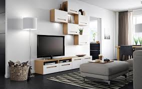 furniture living room wall: a living room with a tv bench in oak with white drawers and wall cabinets with