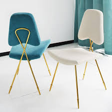 view in gallery modern dining chairs with a glass base brass and metal furniture