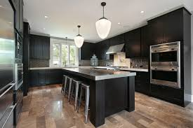 black modern kitchen cabinets with stainless steel countertop four grey bar stools under two pendant black modern kitchen pendant lights