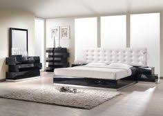 jnm milan modern uniquely designed white button tufted headboard and lacquered black finish bed with lego style casegoodsjnm milan modern uniquely black bed with white furniture