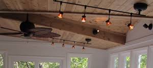 this sunroom has track lighting and ceiling fans for added appeal and convenience cathedral ceiling track lighting