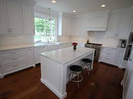 kitchen design entertaining includes: the appliances in this transitional kitchen include a  inch imperial hood disguised beneath a custom hood cover designed by aplus