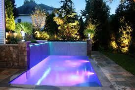 custom landscape lighting ideas around small pool in backyard backyard landscape lighting