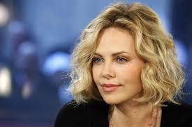 THERE's no lack of men queueing up to take her out nowadays but, amazingly, the boys Charlize Theron fancied at school used to ignore her. - charlize-theron-664311583-96544