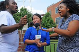youth reporting institute wunc an image of youth reporters dancing