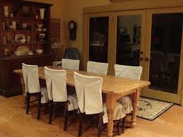rustic hutch dining room: rustic dining room design with white dining chair covers rectangular dining room table and