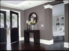 dark wood gray walls and white trim black furniture black furniture wall color