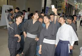 Young <b>men</b> wrapped up in popularity of <b>traditional Japanese clothing</b>