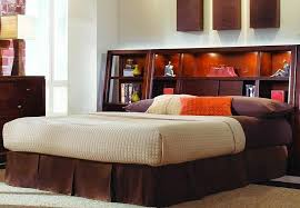 contemporary bedroom with king size storage headboard wooden table lamp beige fabric shades and bedroom headboard lighting