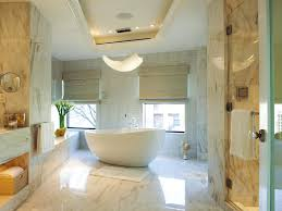bath ideas: gorgeous freestanding oval acrylic bathtub in white with white gloss mosaic granite flooring and wall bath