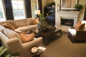 here is a more cozy space filled with pillow backed l shape sectional couch beige sectional living room