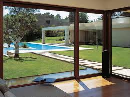 large sliding patio doors: how large sliding glass doors enhance your interior and exterior captivating backyard design which has wooden