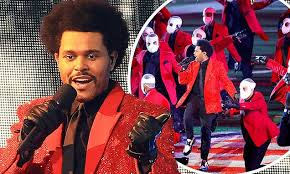 The Weeknd is surrounded by masked dancers and a <b>ROBOT choir</b> ...