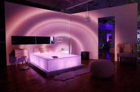 each room featured a custom piece of led embedded acrylic furniturethe bed in the bedroom for examplethat also lit up and acrylic bedroom furniture