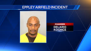 man charged after crashing truck plane at eppley