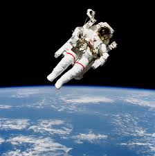 Image result for pictures of man tethered from space ship