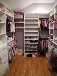 l shaped light brown particle board small walk in closet