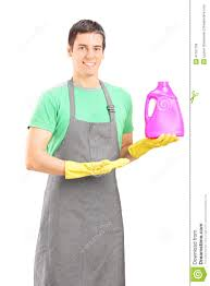 male cleaner advertising a cleaning solution stock photo image male cleaner advertising a cleaning solution