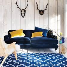 blue sofas living room: i am loving this midnight blue velvet clio sofa graham amp green middot velvet sofa living roomblue