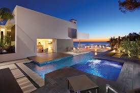amazing beach house with perfect view beautiful outdoor pool design with blue pool lighting and beautiful lighting pool