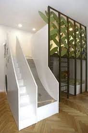this awesome kids room doubles as a playground with a slide climbing ladder and awesome kids beds awesome