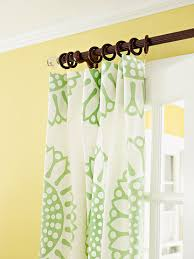 for this living rooms summer look a graphic green and white tablecloth served as the jumping off point thanks to curtain clips tablecloths became the bhg living rooms yellow